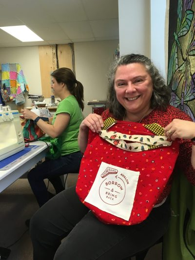 Martha volunteers her time to sew reusable bags for use by local shops in Newfoundland and Labrador.