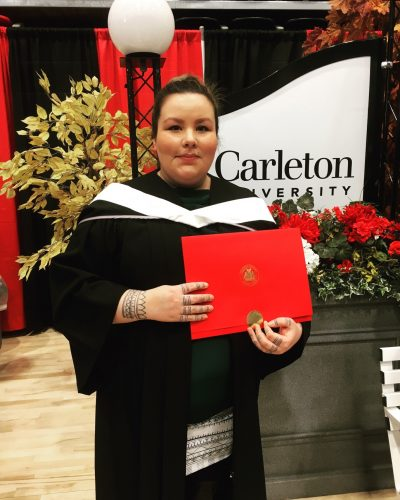 Rebecca receiving her diploma for her MA at Carleton's Convocation in November 2017.